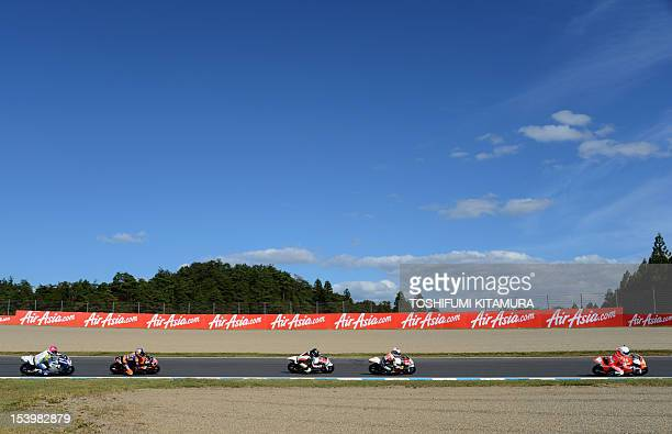 Moto3class Kalex KTM rider Luca Amato of Germany leads FTR Honda rider Louis Rossi of France Honda rider Toni Finsterbusch of Germany KTM rider...