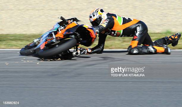 Moto3class KTM rider Niklas Ajo of Finland slides with his bike at a hairpinturn during the second free practice of the MotoGP Japanese Grand Prix at...