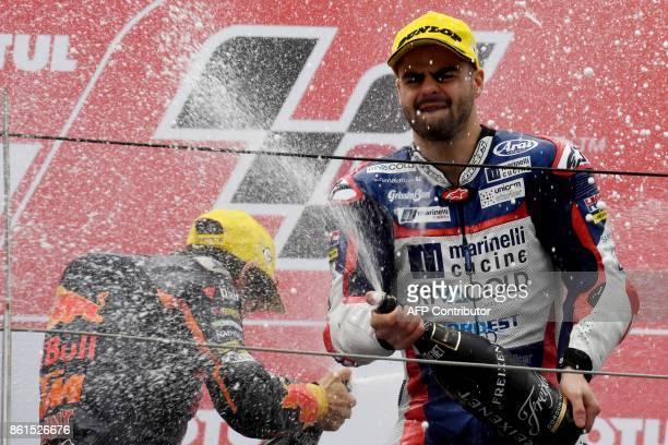 Moto3class winner Honda rider Romano Fenati of Italy sprays champagne with secondplaced KTM rider Niccolo Antonelli of Italy on the podium of the...