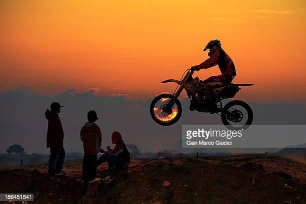 Motocross bike jumping against the sunset.