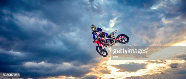 motocross biker in the air - motorcycle racing stock pictures, royalty-free photos & images