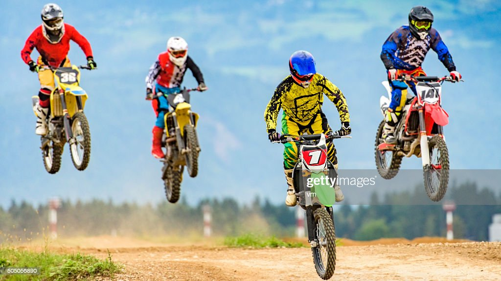 Motocross bikers in the air : Stock Photo