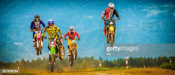Motocross bikers in the air