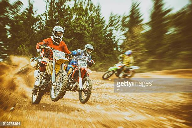Motocross bikers on a dirt road