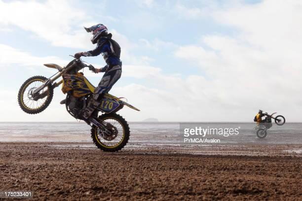 Motocross bikers practice wheelies in the run up to the notorious annual Weston Beach Race held in WestonsuperMare UK