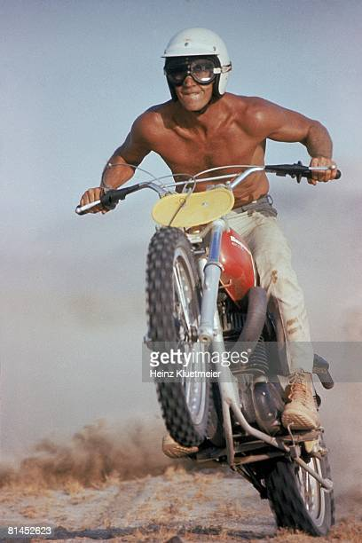 Motocross Celebrity actor Steve McQueen in action on motorcycle Cover Mojave Desert CA 6/13/1971