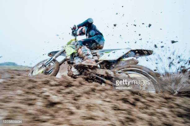 motocross driver during motocross race - オートバイ競技 ストックフォトと画像