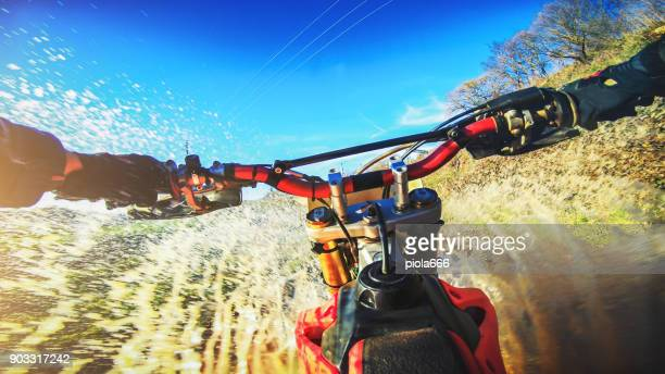 motocross enduro motorbike riding point of view pov - rushing the field stock pictures, royalty-free photos & images