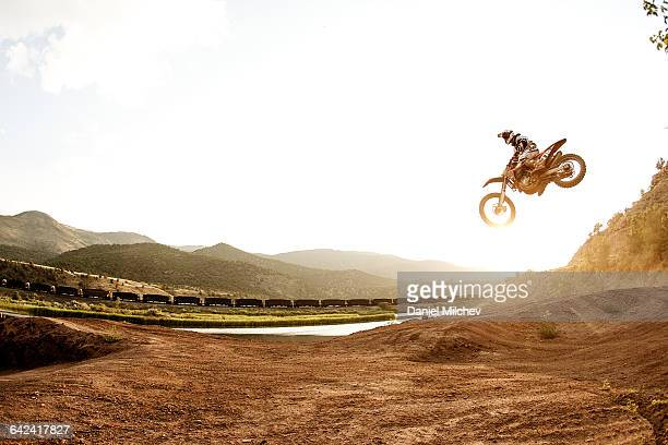 Motocross jump at sunset.
