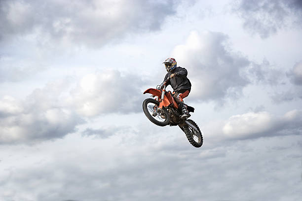 Motocross rider in mid-air, low angle view