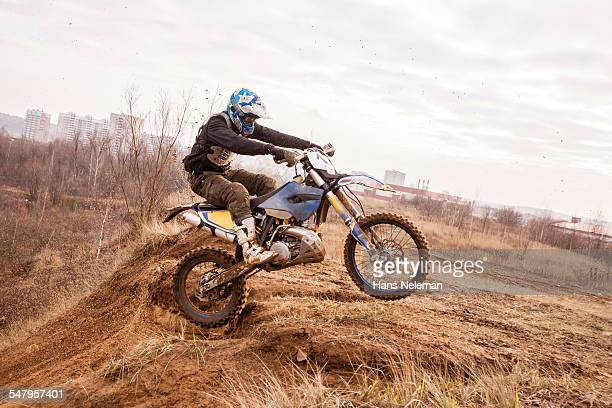 Motocross rider performing in a race track