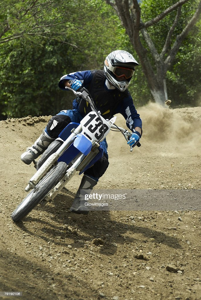 Motocross rider riding a motorcycle : Stock Photo