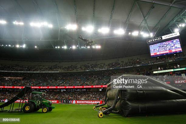 Motocross riders perform before the Big Bash League match between the Melbourne Renegades and the Perth Scorchers at Etihad Stadium on December 29...