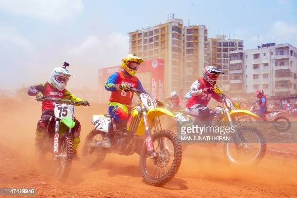 Motocross riders take part in the annual Mogrip SuperCross Championship in Bangalore on June 2 2019