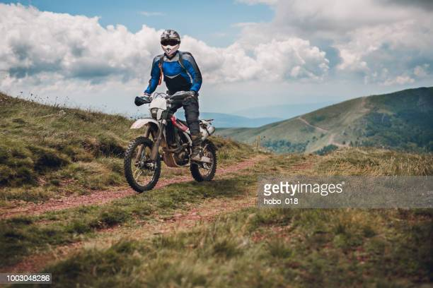 motocross trail rider - scrambling stock pictures, royalty-free photos & images