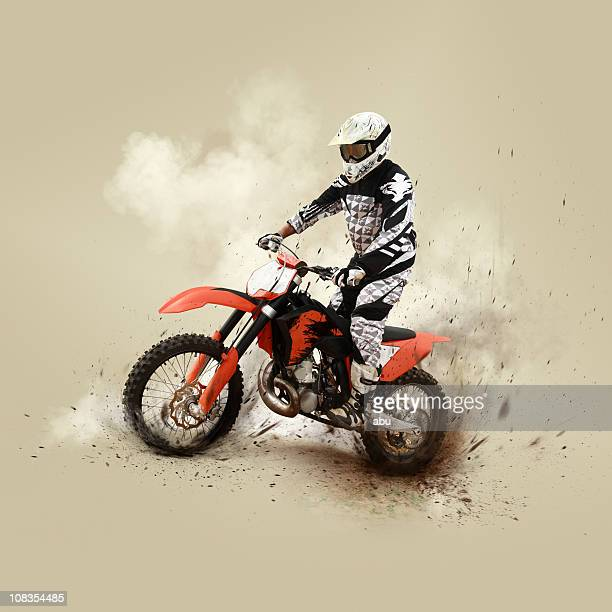 Motocrossing competitor on his motorcycle