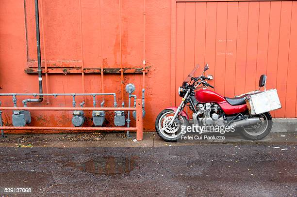 Motocycle in front of a red wall at Flagstaff of Arizona State of USA