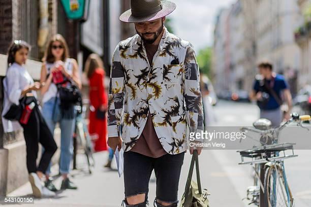 Motofumi Kogi 'Poggy' outside Etudes during the Paris Fashion Week Menswear Spring/Summer 2017 on June 25 2016 in Paris France