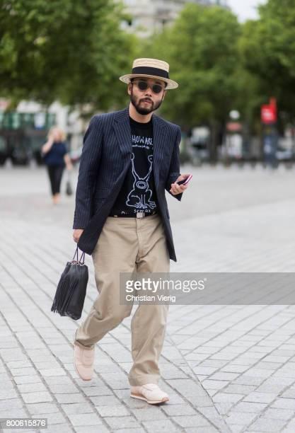 Motofumi Kogi 'Poggy' wearing a straw hat beige pants striped blazer jacket outside Sacai during Paris Fashion Week Menswear Spring/Summer 2018 Day...