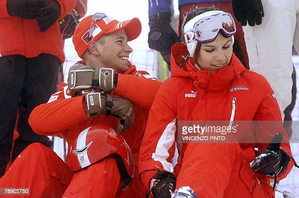 """MotoGP champion Australian Casey Stoner waits with his wife Adriana before a race during the """"Wrooom, F1 and MotoGP Press Ski Meeting"""" Ducati and..."""