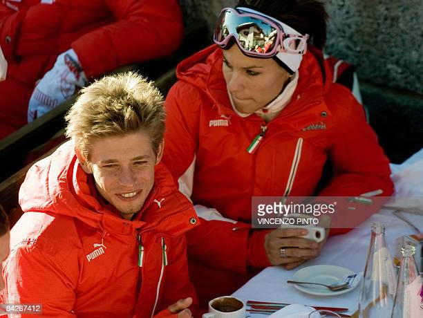 MotoGP Ducati driver Australian Casey Stoner takes a break with his wife Adriana prior skiing during the Wrooom F1 and MotoGP Press Ski Meeting...