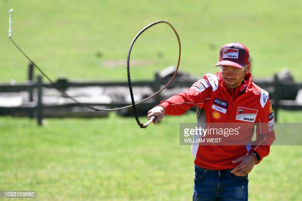 MotoGP Ducati team rider Alvaro Bautista of Spain cracks a whip during a visit to a farm on Churchill Island some 130km south of Melbourne on October...