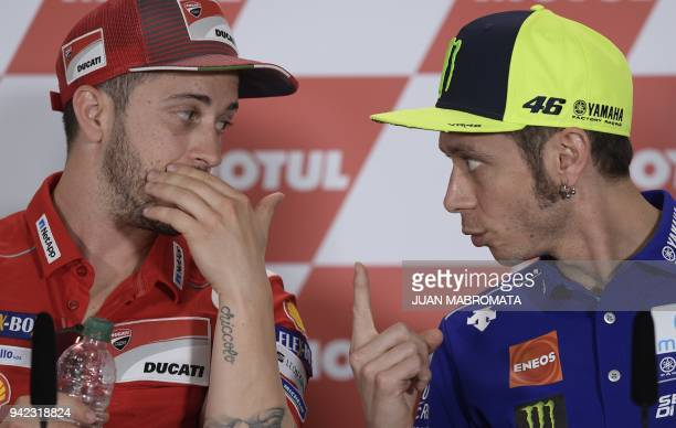 MotoGP Italian bikers Andrea Dovizioso of Ducati and Valentino Rossi of Yamaha chat during a press conference in the framework of the Argentina Grand...