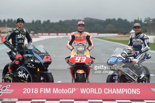 MotoGP over all winner Repsol Honda Team's Spanish rider Marc Marquez poses with Moto2 winner SKY Racing Team VR46's Italian rider Francesco Bagnaia...