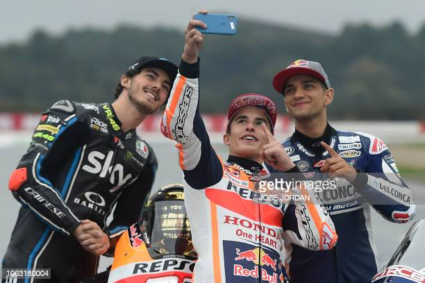 MotoGP over all winner Repsol Honda Team's Spanish rider Marc Marquez poses for a selfie photo with Moto2 winner SKY Racing Team VR46's Italian rider...