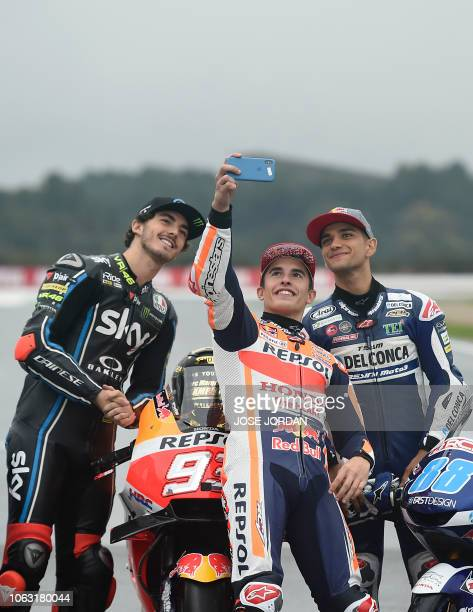 MotoGP over all winner Repsol Honda Team's Spanish rider Marc Marquez poses for a selfie photo with Moto2 winner SKY Racing Team VR46's Italian rider...