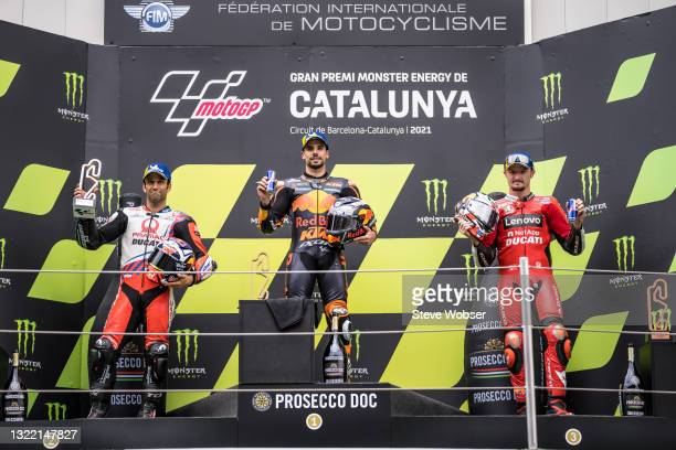 MotoGP podium with Miguel Oliveira of Portugal and Red Bull KTM Factory Racing , Johann Zarco of France and Pramac Racing and Jack Miller of...