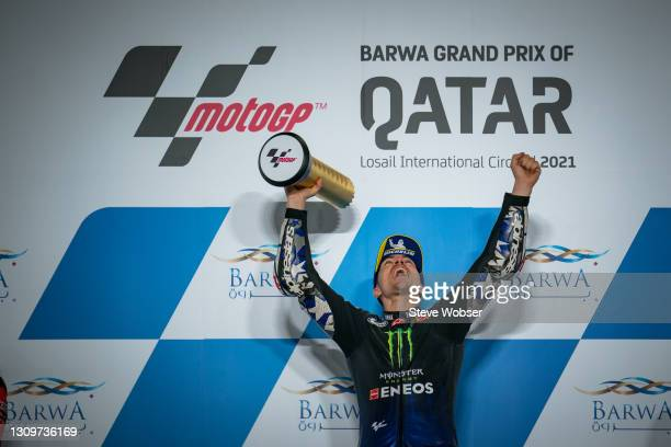 MotoGP race winner Maverick Viñales of Spain and Monster Energy Yamaha MotoGP celebrates with his trophy at the podium at Losail Circuit on March 28,...