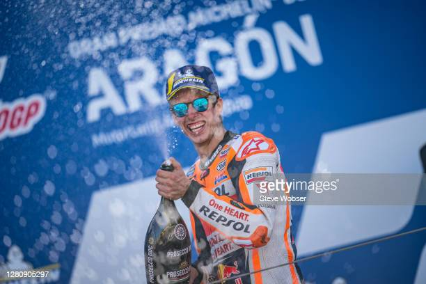 MotoGP rider Alex Marquez of Spain and Repsol Honda Team celebrates his second position with champagne at the podium during the MotoGP of Aragon at...