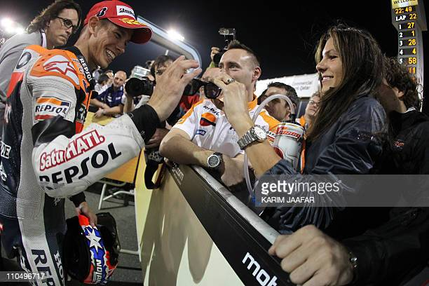 MotoGp rider Casey Stoner of Australia celebrates with his wife Adriana after winning the final race at the Losail International Circuit in Doha on...
