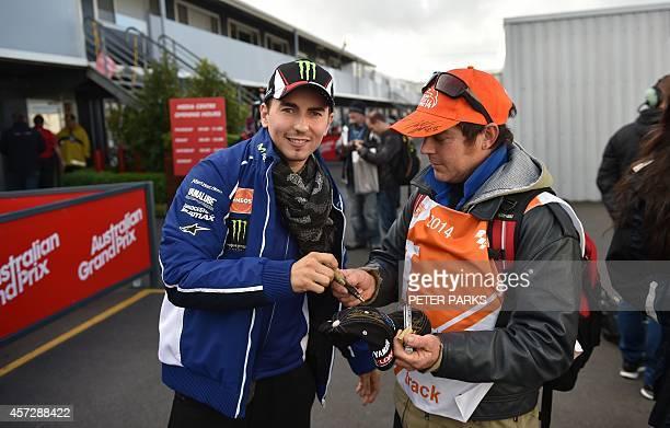 MotoGP rider Jorge Lorenzo of Spain signs autographs in the paddock ahead of the Australian MotoGP Grand Prix at Phillip Island on October 16 2014...