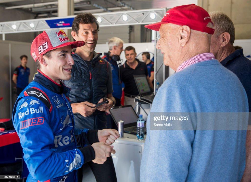 MotoGP rider Marc Marquez of Spain and Repsol Honda Team talks to Niki Lauda prior the F1 testing on June 5, 2018 in Spielberg, Austria.