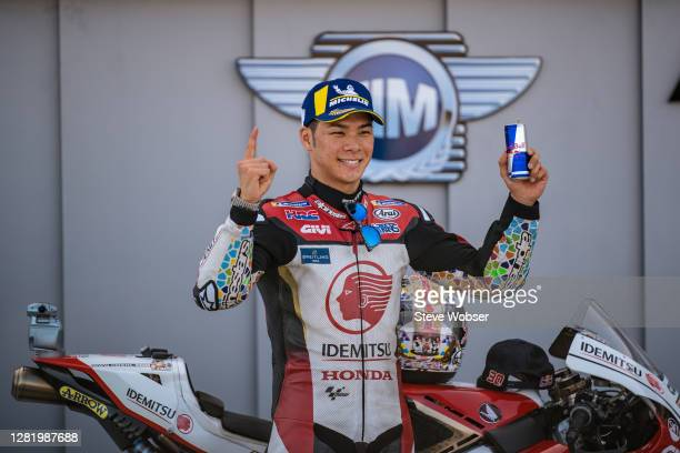 MotoGP rider Takaaki Nakagami of Japan and LCR Honda IDEMITSU stands for a photo with his Red Bull Energy Drink after his pole position during the...