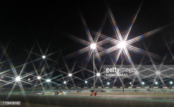 MotoGP riders compete in the fourth free practice session at Losail track near Doha on March 9, 2019 ahead of the season's start at Qatar MotoGP...