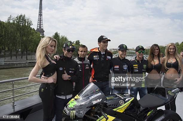MotoGP riders pose during the preevent 'A magical cruise on Seine from the Champs Elyses to the Eiffel Tower' during the MotoGp of France Previews at...
