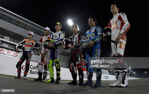MotoGP riders pose for a photo in the Qatari capital Doha on April 10 2009 Eighttime world champion Valentino Rossi and 2007 winner Casey Stoner...