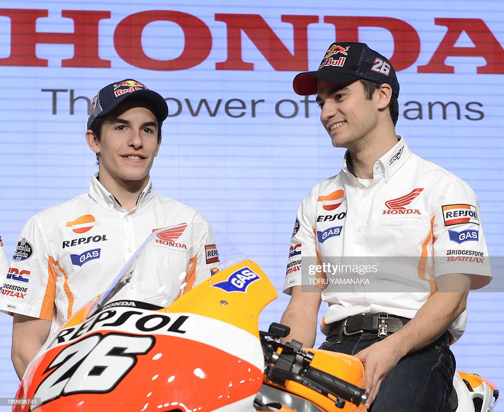 MotoGP Spanish rider Dani Pedrosa (R) and compatriot rider Marc Marquez (L) attend a press conference at the headquarters of Japan's auto maker Honda Motor in Tokyo on February 8, 2013. Honda announced the plans for its motor sports activities this year. AFP PHOTO/Toru YAMANAKA