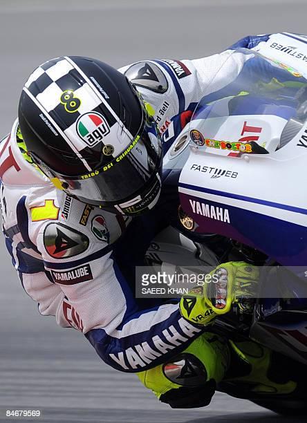 MotoGP word champion Valentino Rossi of Italy powers his bike during a preseason test ride in Malaysia's Sepang International Circuit near Kuala...