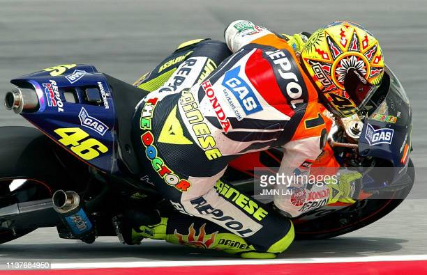 MotoGP World Champion Italian rider Valentino Rossi of Repsol Honda takes a sharp turn during the free practice session of the 2002 Malaysian...