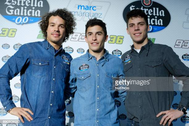 MotoGP World Champion Marc Marquez of Spain and Moto2 World Champion Franco Morbidelli of Italy pose for photographers during an advertising event...