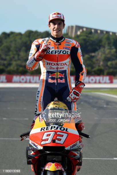 MotoGP world champion Repsol Honda Team's Spanish rider Marc Marquez poses prior to the MotoGP race of the Valencia Grand Prix at the Ricardo Tormo...