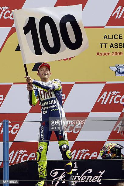 MotoGP world champion Valentino Rossi of Italy celebrates his 100th grand prix victory on the Podium at the Dutch TT race at Assen, on June 27, 2009....