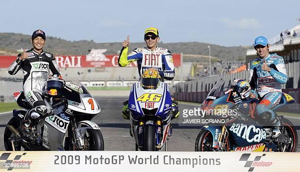 2009 MotoGp World Champions Japanese 250cc rider Hiroshi Aoyama Italian MotoGP rider Valentino Rossi and Spanish 125cc rider Julian Simon pose after...