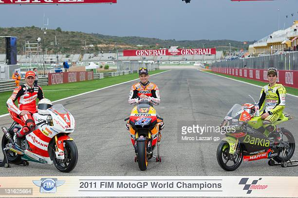 MotoGP World Champions: Stefan Bradl of Germany and Viessmann Kiefer Racing, Casey Stoner of Australia and Repsol Honda Team and Nicolas Terol of...