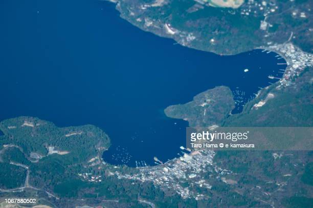 Motohakone area and Lake Ashinoko in Hakone town in Kanagawa prefecture in Japan daytime aerial view from airplane
