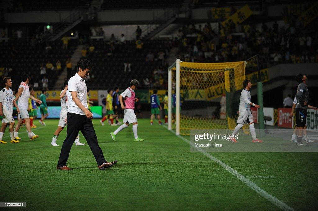 Motohiro Yamaguchi,coach of Yokohama FC looks on after the J.League second division match between JEF United Chiba and Yokohama FC at Fukuda Denshi Arena on June 15, 2013 in Chiba, Japan.